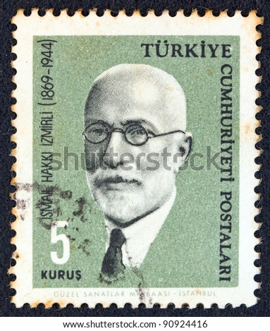 "TURKEY - CIRCA 1964: A stamp printed in Turkey from the ""Famous persons"" issue shows a portrait of Islamist philosopher and author Ismail Hakki Izmirli, circa 1964."