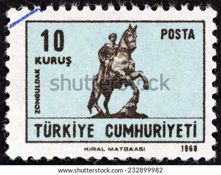 """TURKEY - CIRCA 1968: A stamp printed in Turkey from the """"Greetings Card Stamps """" issue shows equestrian statue of Ataturk at Zonguldak, circa 1968.  - stock photo"""