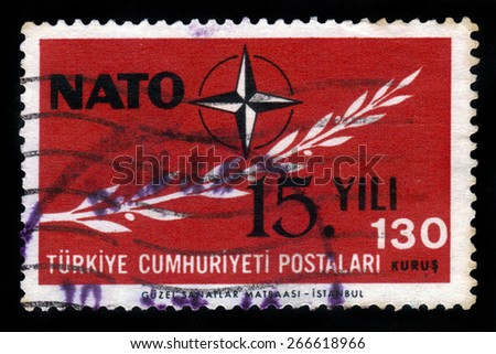 TURKEY - CIRCA 1964: a stamp printed in Turkey shows emblem of NATO (  North Atlantic Treaty Organization ), 15 years NATO, circa 1964 - stock photo