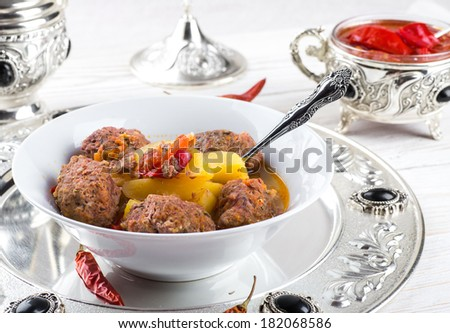 Turkey cutlets with pepper pot on the eastern - stock photo