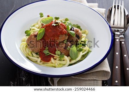 Turkey meatballs with zucchini noodles and tomato sauce - stock photo