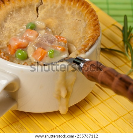 Turkey pot pie with carrot, peas. Selective focus. - stock photo