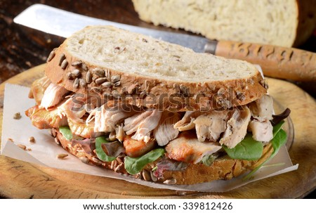 Turkey sandwich freshly made from Christmas turkey leftovers on wholemeal bread.  - stock photo