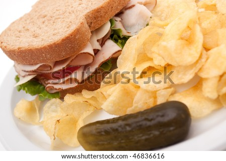 Turkey sandwich meal with potato chips