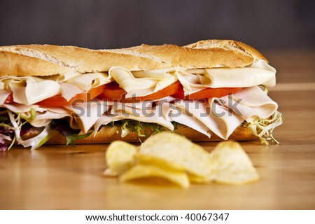 Turkey sandwich with cheese lettuce and tomato - stock photo