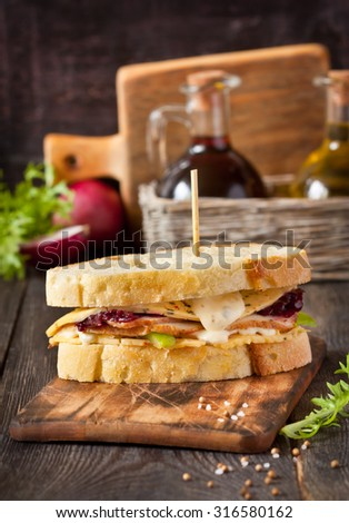 Turkey sandwich with cheese sauce and beetroot jam. - stock photo