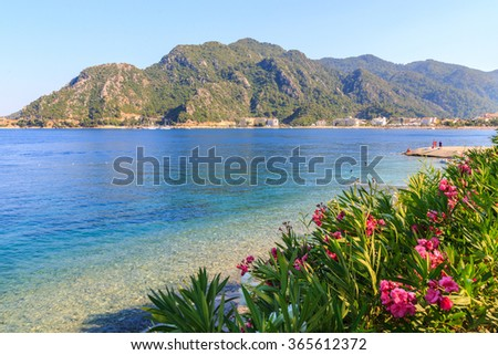 turkey seashore with white san, a ship in the water, summer vacation in europe, asia - stock photo