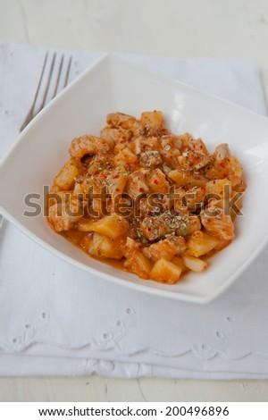 Turkey stew in a white bowl - stock photo