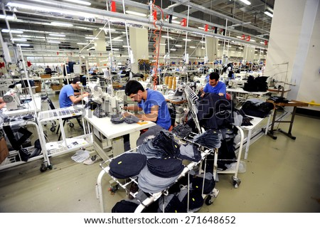 Turkey textile industry,July 24, 2014. Textile is very important sector for turkish economy. At the same time this sector is generating  employment. The workers are seen on the picture in a factory  - stock photo