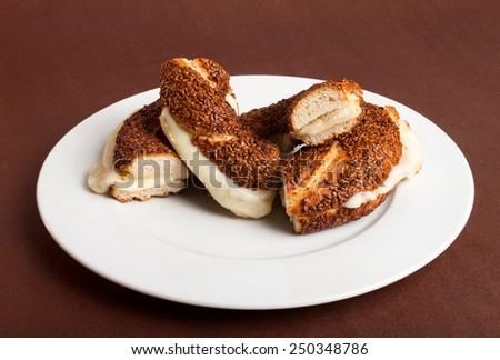 Turkish bagel (simit) on plate - stock photo