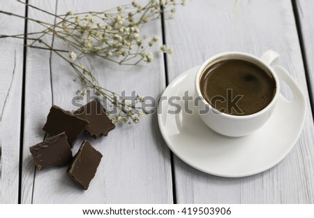 Turkish coffee and chocolate on the wooden table - stock photo