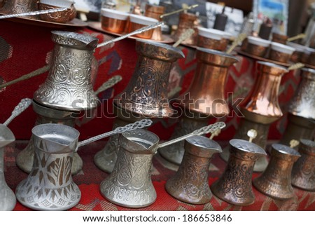 Turkish coffee pot/A small shop selling handmade copper and silver coffee sets. - stock photo