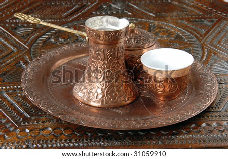 turkish coffee pot and cups on brown wooden table - stock photo