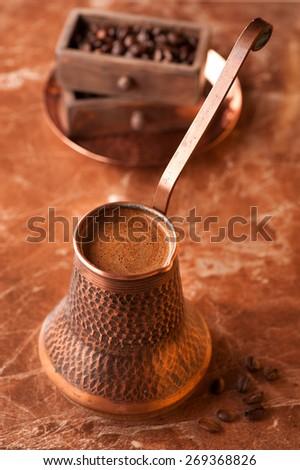 Turkish Coffee Pot. Coffee in the pot - stock photo