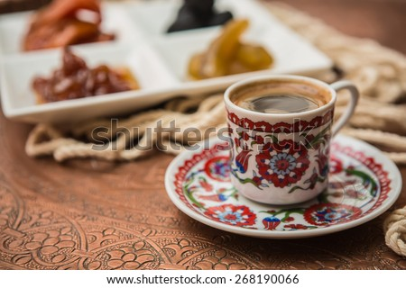 Turkish coffee served in a traditional cup - stock photo