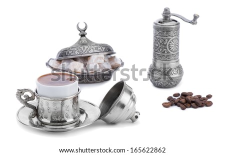 Turkish coffee with Turkish delight and coffee grinder isolated on white background      - stock photo