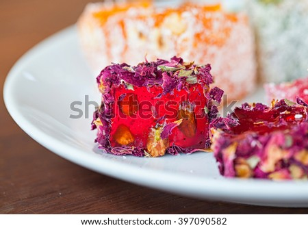 Turkish delight  Rahat Lukum on a white plate, Istanbul, Turkey. Selective focus. Close up.  - stock photo