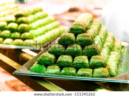 Turkish delights - Traditional Middle Eastern dessert baklava with pistachio nuts. - stock photo