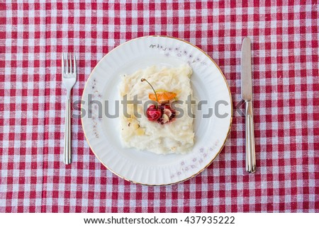 Turkish dessert gullac on a rustic tablecloth top view - stock photo