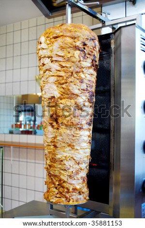 turkish doner kebab meat pit in a fast food shop - stock photo