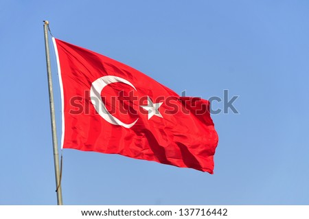 Turkish flag waving in blue sky, Istanbul, TURKEY - stock photo