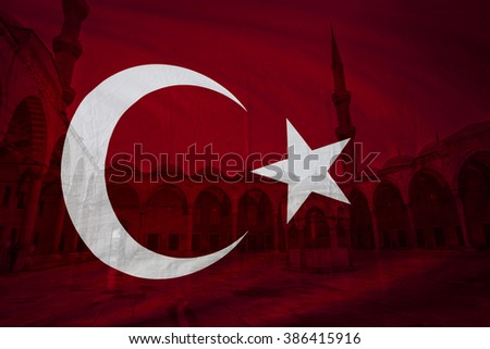 Turkish flag with view of Blue mosque courtyard in Istanbul seen in background - stock photo