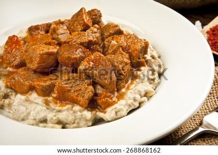 Turkish Food Eggplant and Meat: Hunkar Begendi. Lamb Stew Served on a Bed of Aubergine Puree - stock photo
