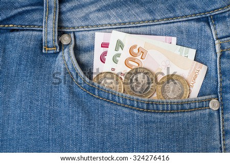 Turkish Lira banknotes and coins in the pocket - stock photo