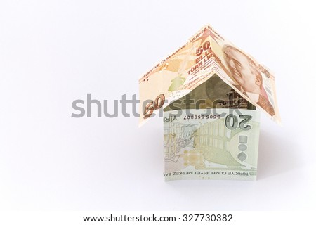 Turkish Lira banknotes in the form of a paper house  - stock photo