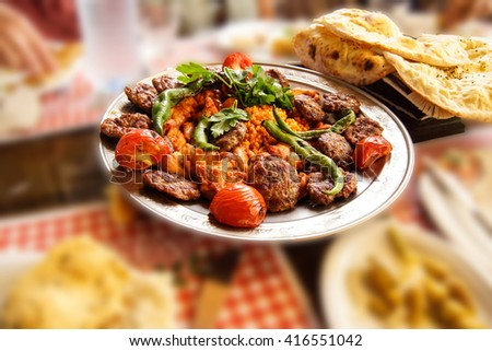 Turkish lunch of meatball kofta, peppers and coos coos bulgar in  Ankara, Turkey - stock photo