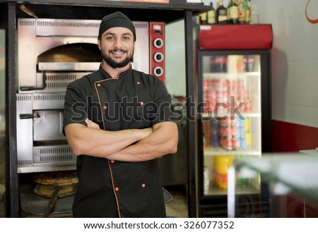 Turkish man posing near to oven