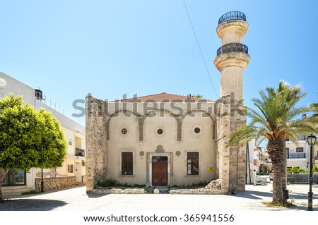 Turkish mosque and old fountain in the town of Lerapetra on the Greek island of Crete. - stock photo