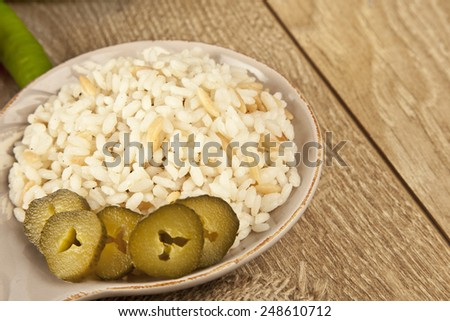 Turkish Rice Pilav with pickle - stock photo
