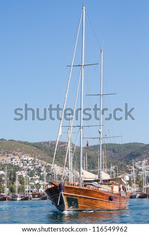 Turkish sailing boat leaving Bodrum harbour , Turkey. - stock photo