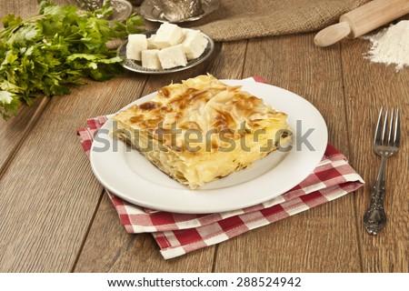 Turkish style meat and cheese stuffed filo dough borek served su boregi - stock photo