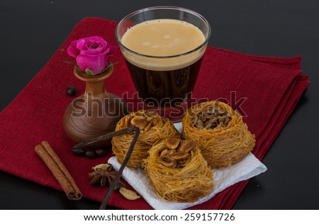 Turkish sweet Delicious with coffee and served flower - stock photo