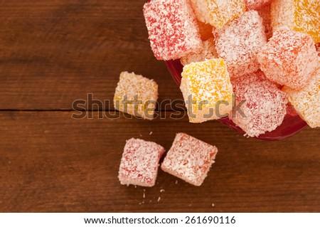 Turkish sweet delights lucum in coconut shavings. Oriental sweets - stock photo