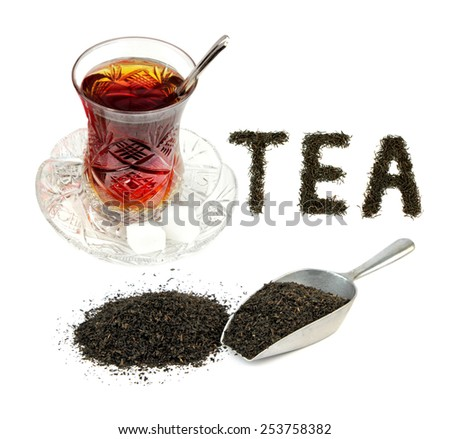 Turkish tea in traditional crystal glass and dry black tea leaves . - stock photo