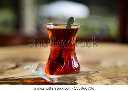 Turkish tea in traditional glass cup - stock photo
