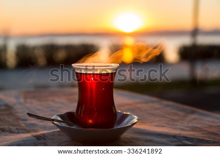 Turkish tea with reverse light image during the sunset for design - stock photo