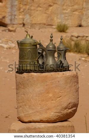 Turkish teapots outside ancient  monastery petra Jordan - stock photo