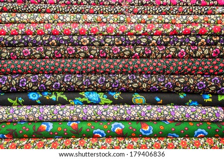 Turkish textiles and fabrics of different colors in the stack
