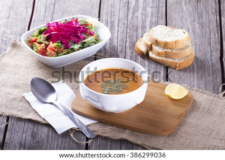 Turkish Traditional Lentil cream soup with salad and bread slice , ezogelin, tarhana - stock photo