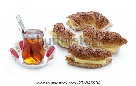 Turkish traditional sesame bagel ( Simit ) sandwich with cheddar cheese. And Turkish Tea. - stock photo