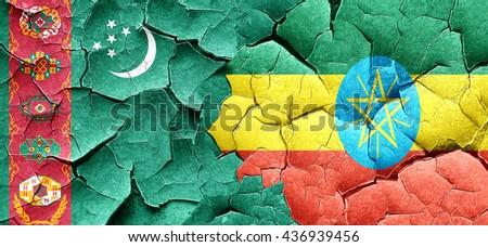 Turkmenistan flag with Ethiopia flag on a grunge cracked wall - stock photo