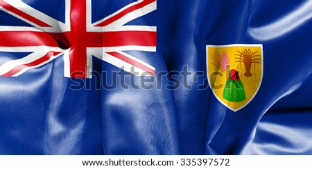 Turks and Caicos Islands flag texture creased and crumpled up with light and shadows - stock photo
