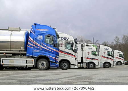 TURKU, FINLAND - APRIL 5, 2015: Five modern Volvo FH trucks parked on a yard. The process of developing a new truck starts many years before it is launched.