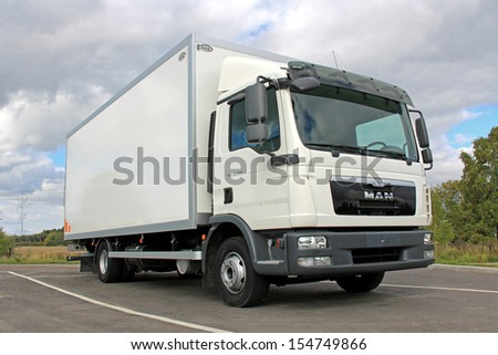 TURKU, FINLAND - SEPTEMBER 15: MAN TGL 12.220 delivery truck on September 15, 2013 in Turku, Finland. MAN SE reports that MAN is included to Dow Jones Sustainability World and Europe Indices again. - stock photo