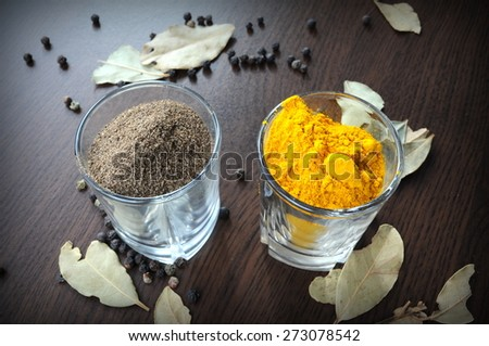 Turmeric and pepper. Turmeric and black pepper combo is great for health. Black pepper not only increases bioavailability of turmeric but also provides several other health benefits. - stock photo