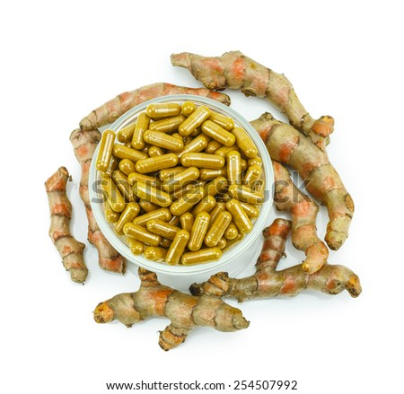 Turmeric (Curcuma longa L.) root and turmeric capsules for alternative medicine ,spa products and food ingredient. - stock photo